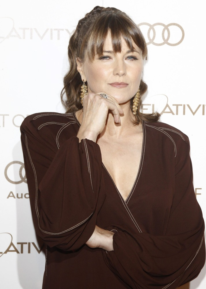 Lucy Lawless Braless Photos