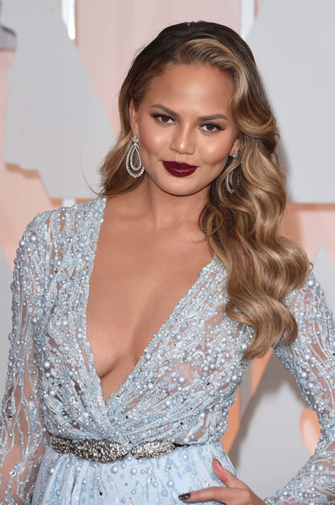 Chrissy Teigen Braless Photos